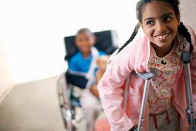 injured girl using crutches PHOTO